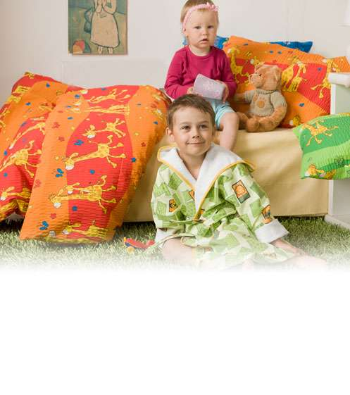 Dětské povlečení s motivem žirafek na oranžovém Dadka